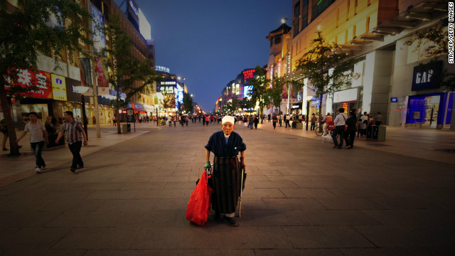 A file image of 90-year-old Li Xiuying collecting bottles and cardboard boxes to sell for recycling in Beijing, 2010.