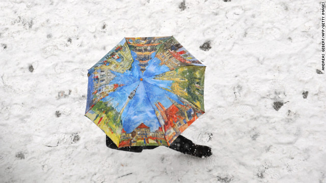 A person walks through the snow at Marienplatz in Munich, Germany, on February 26.