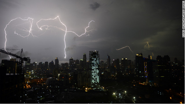 Lightning strikes over Jakarta's skyline late on March 3 during monsoon rains.