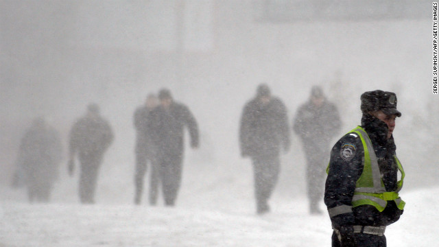 A traffic police officer patrols during heavy wind and snowfall in Kiev, Ukraine, on March 4.