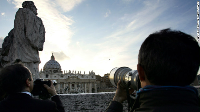 The last conclave was in 2005, when Benedict's XIV was annoucned as pope. Here photographers watch the chimney for smoke- black for failure and white for success on April 18, 2005. 