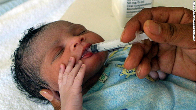 A girl, 1 hour old, receives an anti-retroviral drug in South Africa to prevent infection from the HIV virus carried by her mother.