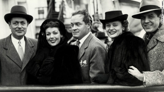 Screen star Bob Hope (center) was one of many celebrities who stayed on board the Queen Mary, jumping aboard for her final passenger voyage before World War II. 