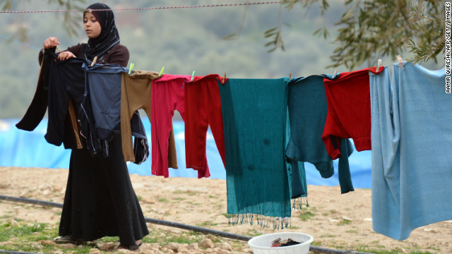 Clothes dry at the Qah refugee camp near the Turkish border on January 31. Many Syrians are forced to flee with few or no belongings.