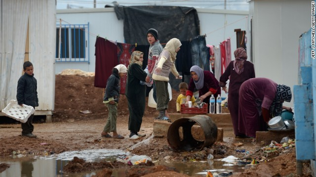 Syrian children gather around women washing in the Zaatari refugee camp on January 31.