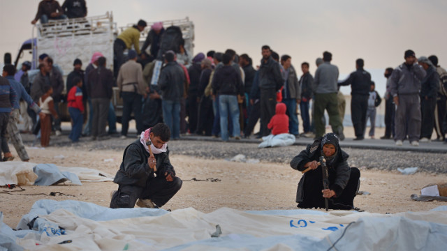 Syrians put up tents at the Zaatari refugee camp on January 30.