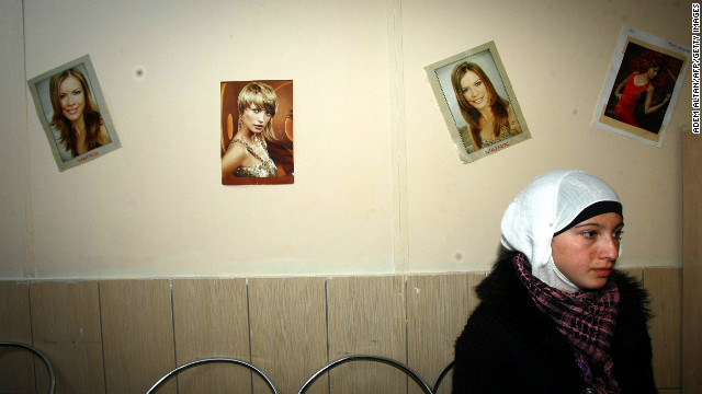 A Syrian refugee waits November 27, 2012, at a hairdresser's shop, where refugees can also receive training, inside the Oncupinar camp in Kilis, southern Turkey.