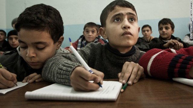 A Syrian boy attends school in the Turkish town of Kilis on December 17.