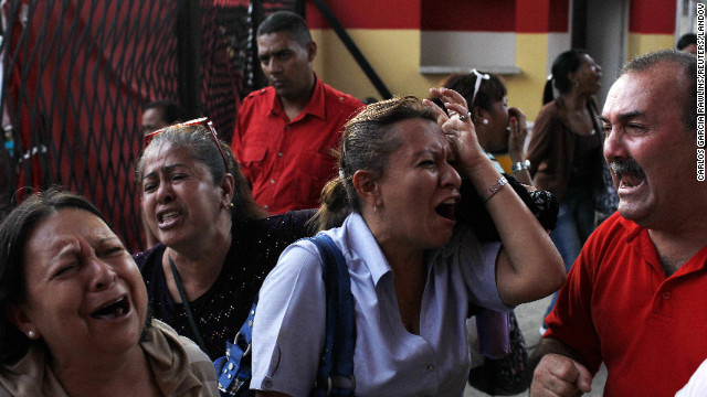 Venezuelans in Caracas react to the news of Chavez's death on March 5.