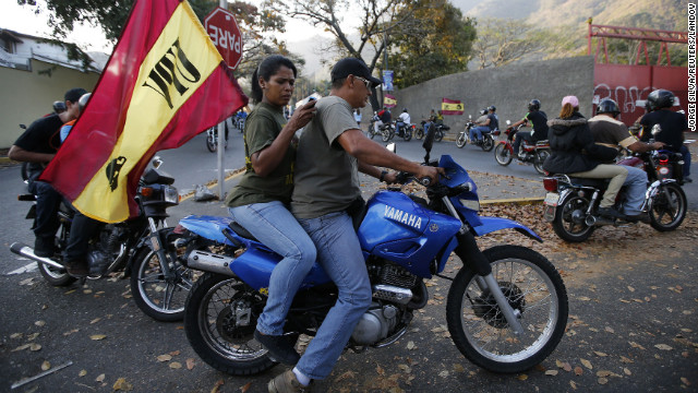 Venezuelans ride motorcycles through Caracas after the announcement of Chavez's death on March 5.