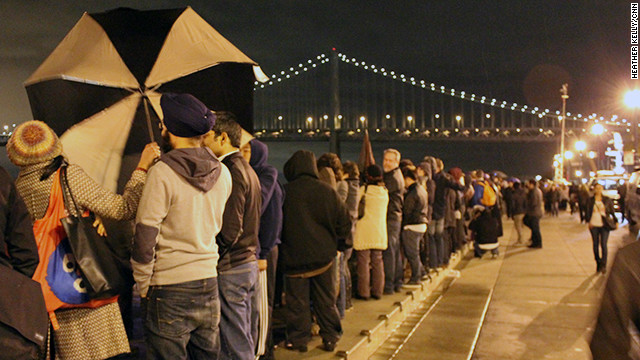 People lined up along the Embarcadero in San Francisco ahead of the light show.