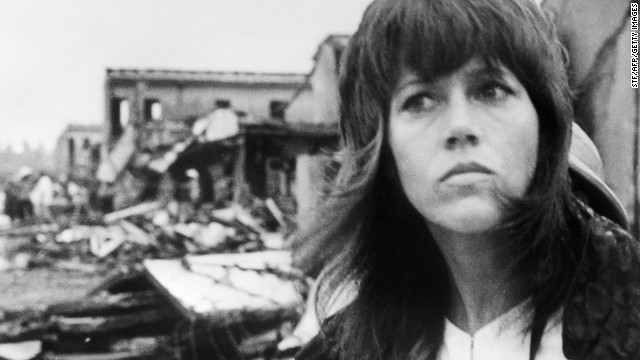 In 1972, actress Jane Fonda visited North Vietnam in protest of the Vietnam War. Fonda's visit to Hanoi was marked by a number of controversial events, including a picture showing Fonda seated on an anti-aircraft battery used against U.S. forces. Fonda later apologized for the photo and for the harm it may have caused servicemen and their families. In the photo above, Fonda tours destruction in Hanoi on July 25, 1972.
