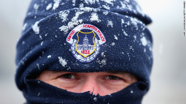 U.S. Capitol Police officer Alex Rys' hat is dusted with snow as he patrols on Capitol Hill on March 6.