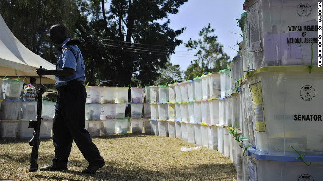 An armed security officer guards ballot boxes on March 5, 2013 that have yet to be tallied in Kakamega, western Kenya, a day after the country held national elections.