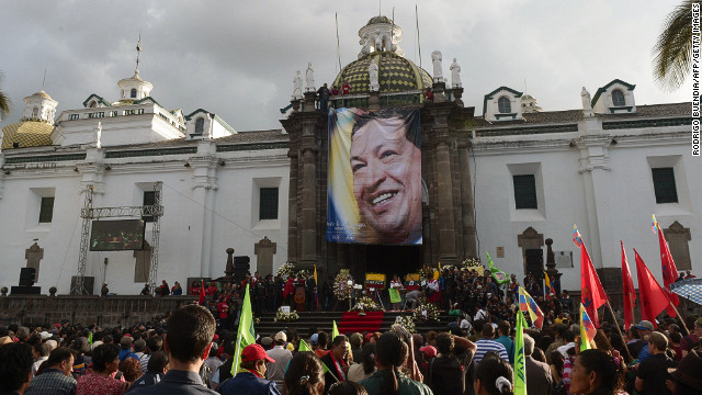 Crowds in Quito, Ecuador, gather around a large photograph of Chavez to pay their respects to the deceased president on March 6. Ecuador's left-leaning president, Rafael Correa, was a Chavez ally. 