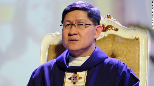 Cardinal Luis Antonio Tagle, Archbishop of Manila, sits during a mass at a Catholic gathering in the Philippine capital on February 16, 2013. Filipinos are hoping that 56-year-old Tagle, who was only made a cardinal last year, could become the next pope following the shock announcement by 85-year-old Pope Benedict XVI.