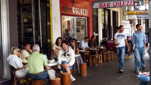Founded by Roman immigrant and former boxing champion Luigi Coluzzi, <a href='http://www.travelandleisure.com/restaurants/bar-coluzzi-sydney-airport-syd' target='_blank'>the curbside café</a> has been Darlinghurst's de facto community center since 1957. Order a flat white (the espresso is as powerful as Luigi's uppercut), claim one of the foot-high sidewalk stools, and watch the entire neighborhood pass by. $