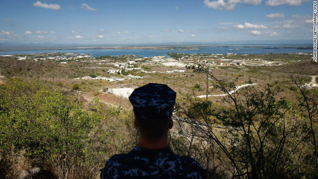A Navy sailor surveys the U.S. naval base at Guantanamo Bay in October 2009. In December 2013, Congress <a href='http://ift.tt/1eH6jTj' target='_blank'>passed a defense spending bill</a> that makes it easier to transfer detainees out of the facility.