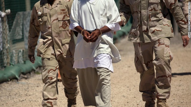 U.S. military guards move a detainee inside the detention center in September 2010. At its peak, the detainee population reportedly exceeded 750 men at Guantanamo.