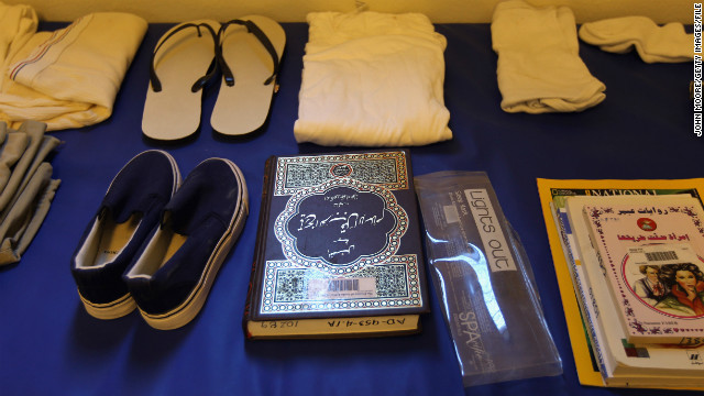 A Quran sits among a display of items isssued to detainees in September 2010. The suspects are given a prayer mat and a copy of the Muslim holy book as well as a toothbrush, soap, shampoo and clothing.