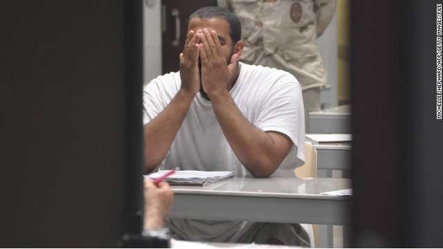 "A detainee rubs his face while attending a ""life skills"" class inside the Camp 6 high-security detention facility in April 2009."