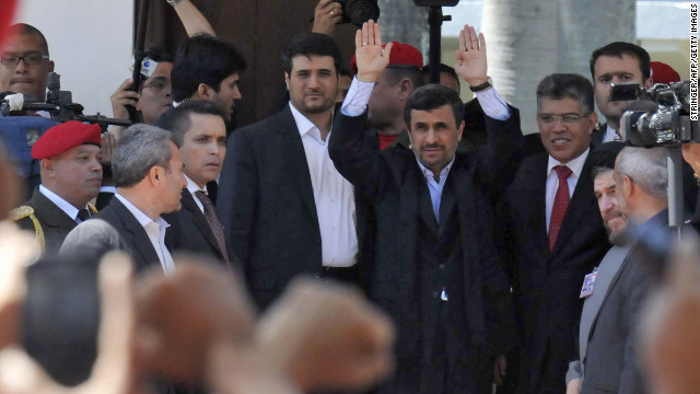 Iranian President Mahmoud Ahmadinejad, center, waves alongside Venezuelan Minister of Foreign Affairs Elias Jaua outside of the funeral of the President Hugo Chavez in Caracas, on March 8.
