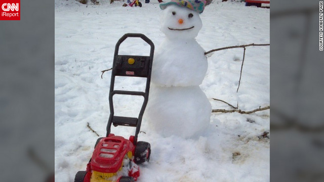 "Kimberly Page from Dillwyn, Virginia, spent her snow day this week with her daughters. On the morning of March 7, she and her two toddlers came together and built a snowman. ""I just like being able to enjoy my snow days with my two little girls. They love playing in the snow, but we had to get outside early this morning before it all melted away,"" she said."