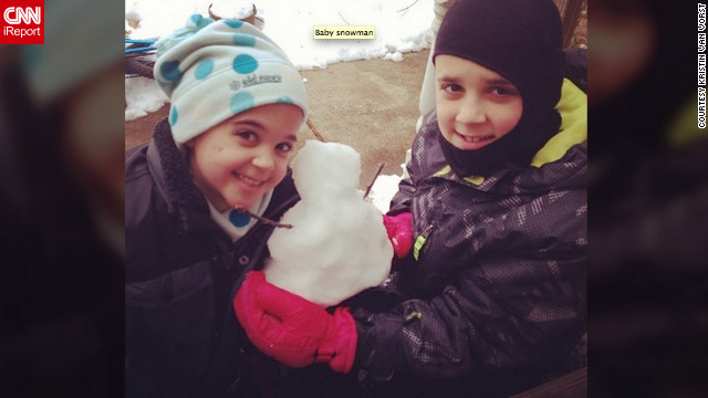 "Kristin Van Vorst from Spotsylvania, Virginia, says her area got more than 8 inches of snow. She and her children, Sydney and Elliot, went outside to play in the fresh snow, and built this tiny snowman. ""The best part of a snow day is extra time together,"" she said."