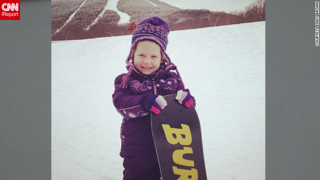 "Emily Brown says she and her family spent their snow day hitting the slopes in Jay, Vermont. ""We don't get to come to Jay very often, but getting my daughter on a board for the very first time has been the most amazing experience,"" she said. Her favorite part of the day was being with her family and ""doing what we love all together,"" she said."