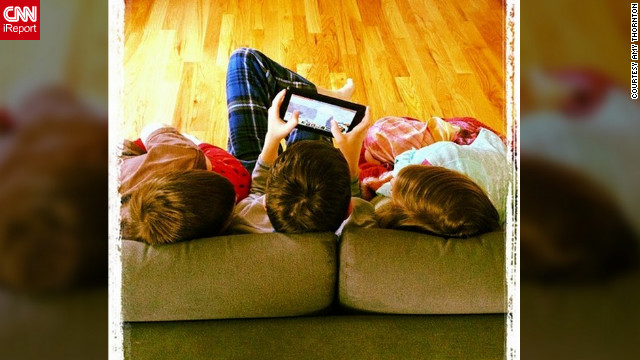 "Amy Thornton from Crozet, Virginia, woke at eight in the morning and found her three young children huddled together on the living room couch, playing with their Kindle. ""A snow day is like this little stolen moment. Stolen from routine and rat-race,"" she said. ""The highlight was getting to all play together, making memories."""