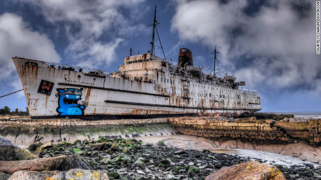 Former cruise liner, the <i>Duke of Lancaster</i>, was docked on the banks of the Dee Estuary in north Wales three decades ago. It has now become a canvas for graffiti artists from across Europe.