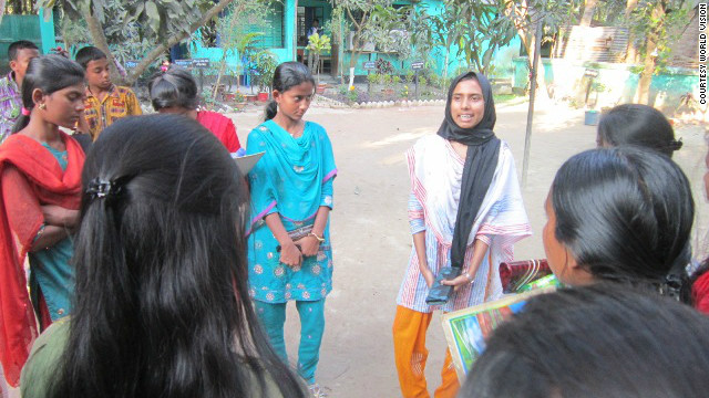Humaiya Akhter (R) works with young girls in Bangladesh to raise awareness about the damaging effects of child marriage. 