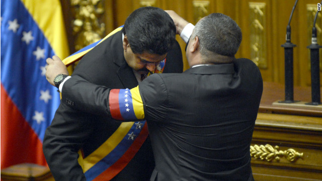 Vice President Nicolas Maduro is sworn in as president, which led to criticism from political opposition.