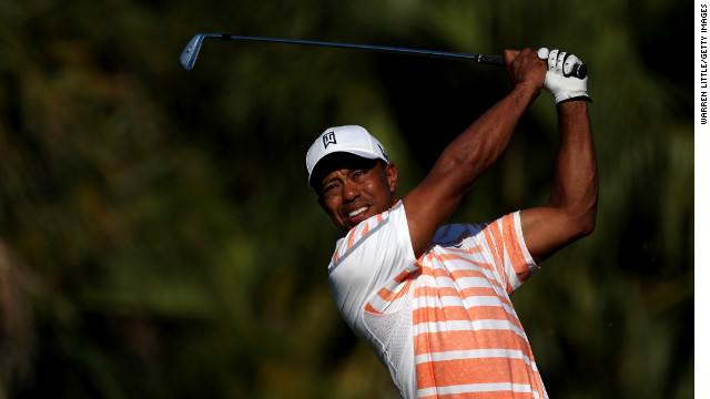 Tiger Woods makes another confident shot during his seven-under-par 65 at Doral's Blue Monster course in Florida.