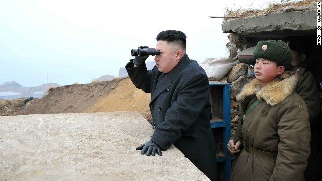 Kim uses a pair of binoculars to look south from the Jangjae Islet Defense Detachment, near South Korea's Taeyonphyong Island, on Thursday, March 7.