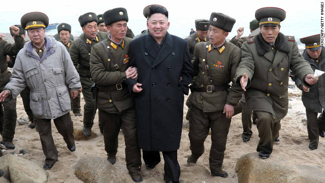 Kim is surrounded by soldiers during a visit to the Mu Islet Hero Defense Detachment near South Korea's Taeyonphyong Island on March 7. North Korea has escalated its bellicose rhetoric, threatening nuclear strikes, just before the U.N. Security Council passed tougher sanctions against the secretive nation on March 7.