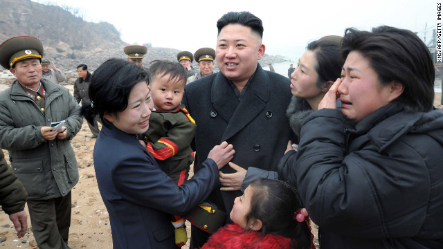 Kim is greeted by the family of a soldier as he inspects Jangjae Islet Defense Detachment near South Korea's Taeyonphyong Island in South Hwanghae province on Thursday, March 7, in a photo from the state-run Korean Central News Agency.