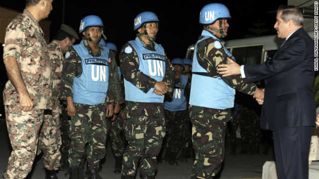 Jordanian Foreign Minister Nasser Judeh greets U.N. peacekeepers after their release on the Syria-Jordan border Saturday. 