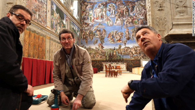Workers set up inside the Sistine Chapel as preparations begin before the papal conclave on March 9.