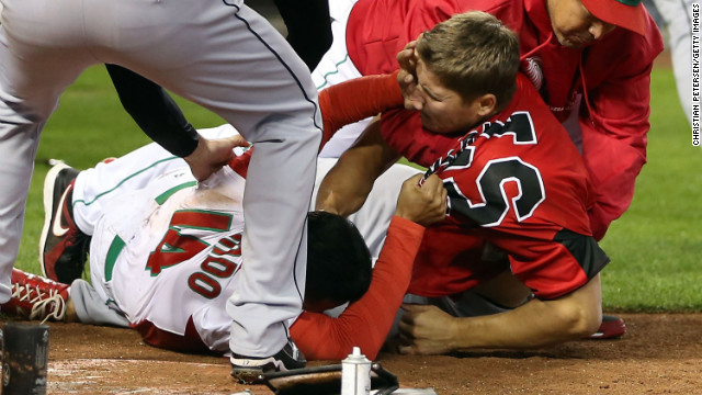 Eduardo Arredondo (left) of Mexico fights with Jay Johnson of Canada during the World Baseball Classic on March 9.