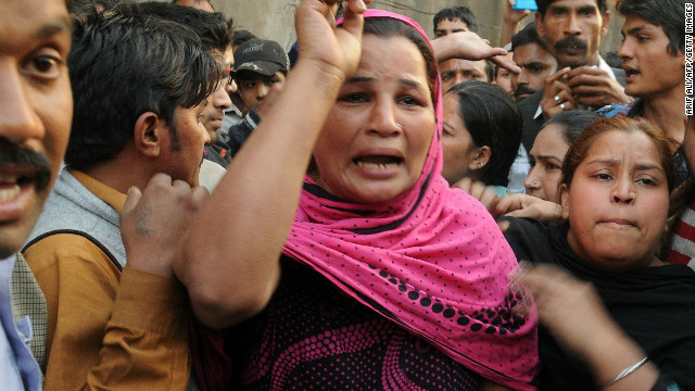 Pakistani Christians react after Muslim demonstrators destroyed the homes of members of the Christian community.