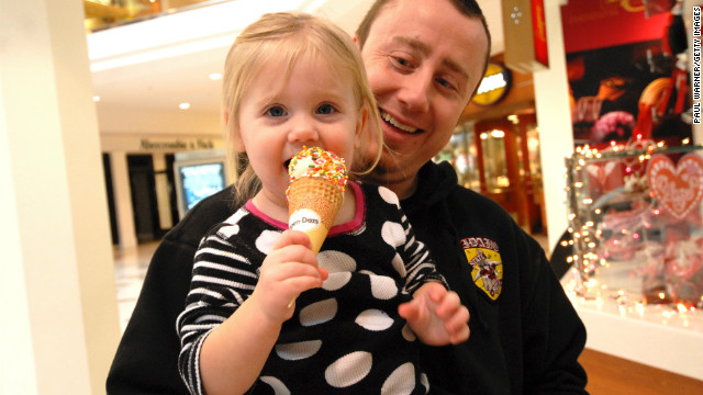 A Michigan dad takes his daughter on an outing. Kathleen McCartney says working mothers' issues are fathers' concerns, too