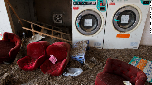 A laundry shop remains deserted about 20 kilometers (12 miles) from the Fukushima Daiichi nuclear facility on Sunday. The earthquake knocked the power plant offline, resulting in a meltdown of three reactors.