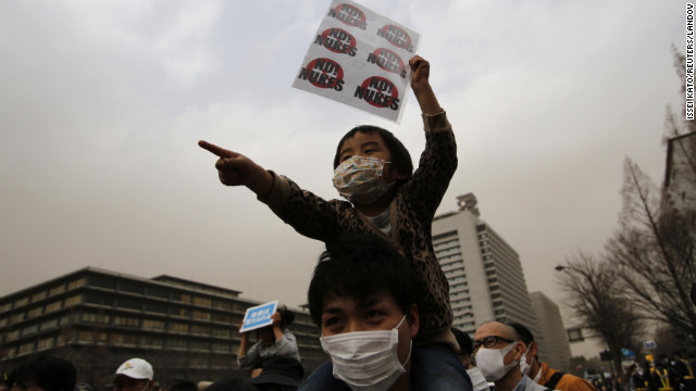 A boy takes part in an anti-nuclear march in Tokyo on Sunday. The radiation crisis that stemmed from the earthquake and tsunami shattered public trust in nuclear power.