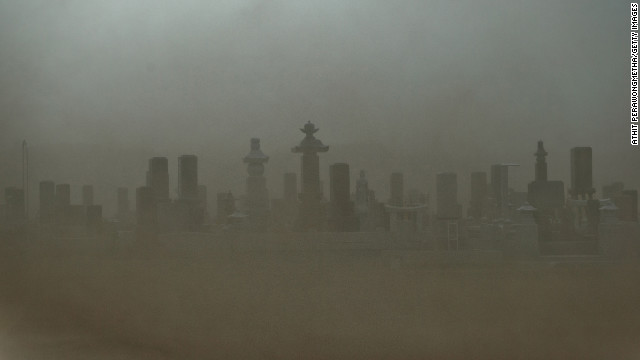 A cemetery in Odaka has low visibility in heavy wind on Sunday. The city became a nuclear ghost town after the 2011 disaster.