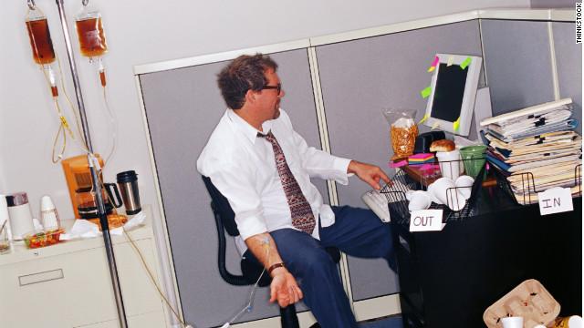 130311171908-businessman-at-messy-desk-w