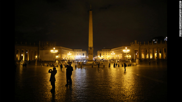 A few pilgrims are present in St. Peter's Square as night falls on Monday, March 11. Roman Catholic cardinals from around the world will assemble in the Vatican's Sistine Chapel to start the process of electing a new pope on March 12 to replace Benedict XVI, who resigned.