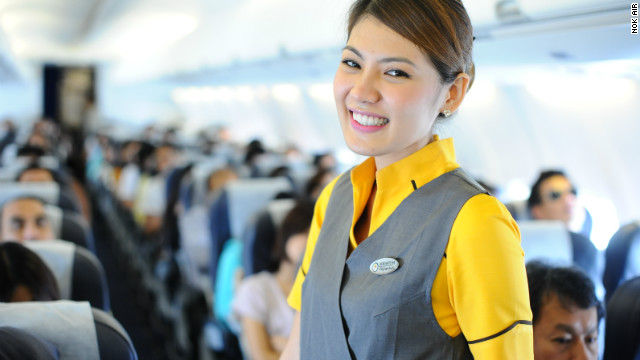 An actual flight attendant from Nok Air smiles for the camera. Nok Air's CEO Patee Sarasin says no flight attendant is over 30 because customers prefer younger staff. 