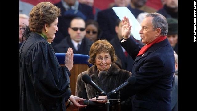 Bloomberg is sworn in by New York Judge Judith S. Kaye as Bloomberg's mother, Charlotte Bloomberg, holds the Bible on the steps of City Hall in January 2002.