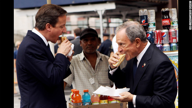 British Prime Minister David Cameron eats a hot dog with Bloomberg outside New York's Penn Station on July 21, 2010. Cameron met with Bloomberg and U.N. Secretary General Ban Ki-moon in New York during his visit.